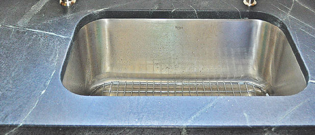 Soapstone counters are durable. Scratches can be easily removed from soap stone with sand paper.