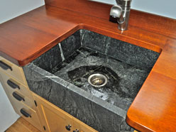 Custom wood countertops can be installed in the kitchen or bathroom. The wood counter pictured in this nh home was installed by Seacoast Soapstone