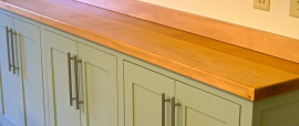 Our custom wood countertops and cabinets are a perfect complement to soapstone.